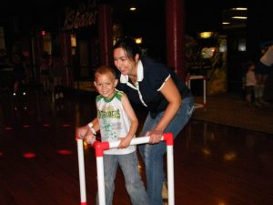Mommy helping Jay skate