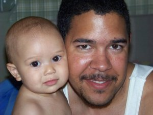 "My husband with baby Hannah. Will created ""the baby bump"" as a non-verbal way to communicate ""I love you"" to our baby."