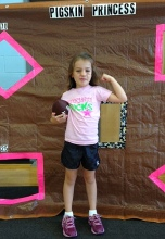 Giuliana, 5, flexes her muscles at football practice at the Pigskin Princess Project.  Permission granted from all parents to use photos