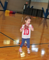 Gracie, 3, gets ready to throw like a girl at the Pigskin Princess Project.  Permission granted from all parents to use photos.