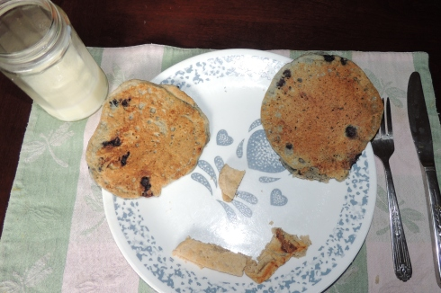 After my daughter helped make pancakes, she arranged them into a funny face and took a picture.  I don't know where she got the idea to photograph her food!  ;)