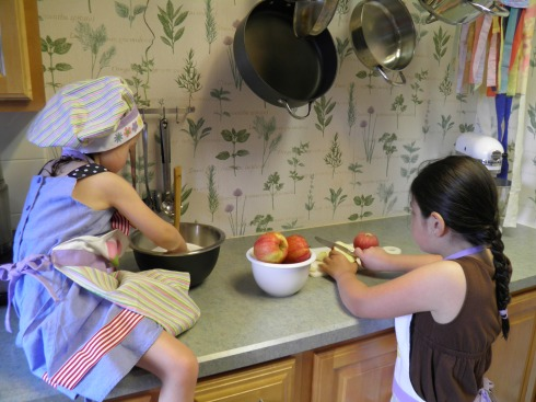 This picture is almost three years old, but it shows how long we've been cooking together.  Here we were making a pie after a trip to the orchard.
