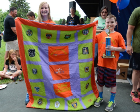 Lap4life presented a trophy to M.J. and Sean Cadden for their bravery and courage.  A quilt made with police badges sent to Sean while he was at Westchester Medical Center. Police departments all over the country sent him badges to decorate his room.