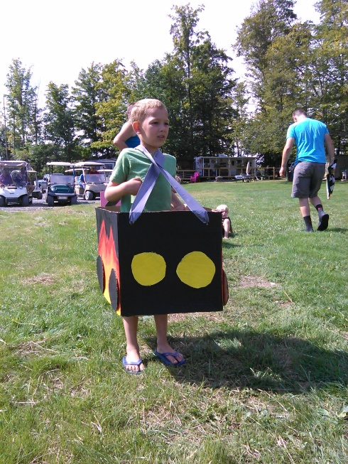 They had a cardboard board box race. The kids ran the course making pit stops to have their windshield cleaned (they got squirted in the face with water), change their tires (their shoes had to be taken off and put back on and laces tied) and they had to refuel (chug a gatoraide) in between laps. It was so cute I'm stealing this idea for my daughter's birthday party this week.