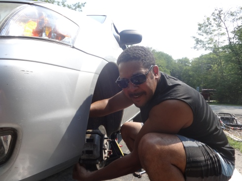 My amazing husband changing the break pads on our mini-van before we head out on our camping trip.