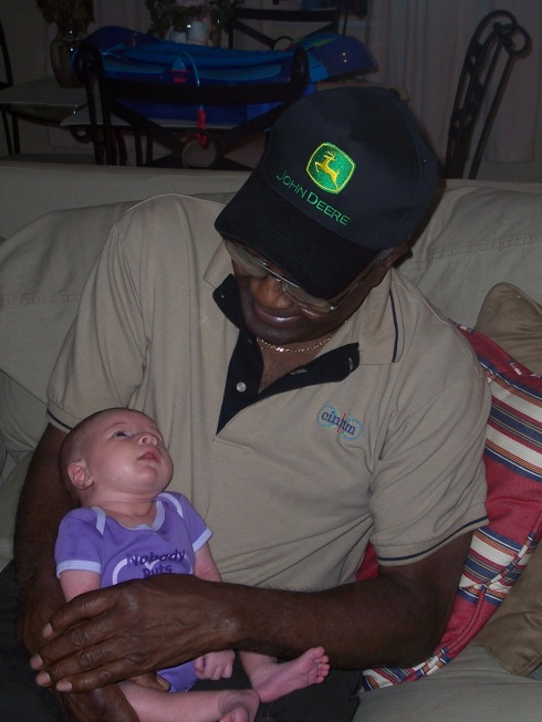 My father-in-law Willie Johnson, Sr. (Skip) with baby Hannah.