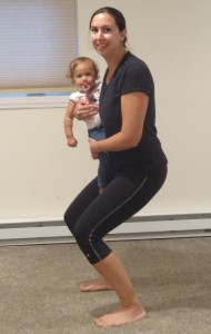 Doing squats while holding your baby is good for you and fun for them.