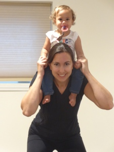 Sydney loves when I do squats with her on my shoulders, especially when I do it in front of my hall mirror, which creates a game of Peek-a-boo with herself.