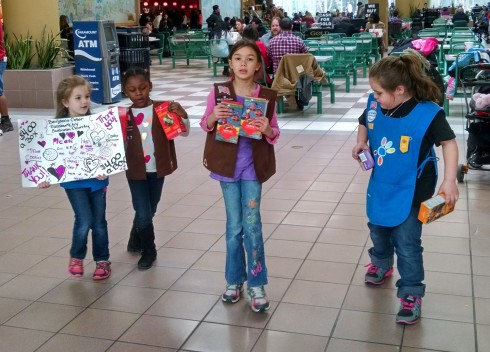 Even the shy girl scouts came out of their shells to help sell cookies at the mall last year. Some of them held signs or sang songs, while others took money and gave out boxes of cookies. You could see their confidence growing throughout the day and they sold every last box, all 21 cases which is 252 boxes. It was a great team effort!