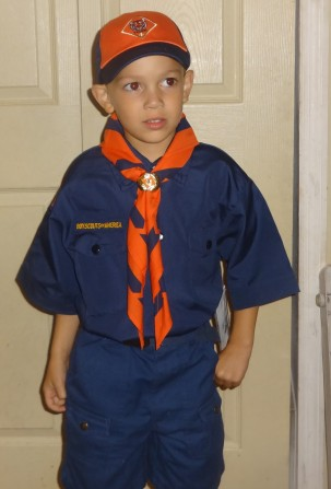 Jayden tries on his uniform for his first year as a Cub Scout.